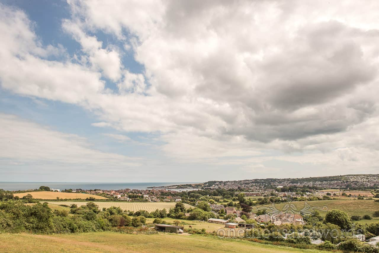View over Swanage and Dorset seaside from Purbeck marquee wedding photographs by one thousand words wedding photography