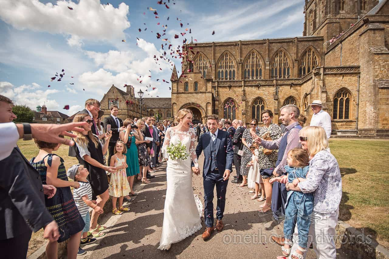 Wedding confetti photograph bride and groom at Sherborne Abbey wedding photographs by one thousand words photography