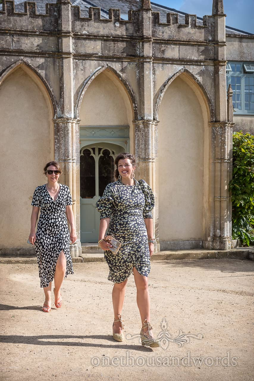 Wedding guests wearing black and white patterned dresses at Sherborne Castle wedding by one thousand words photography