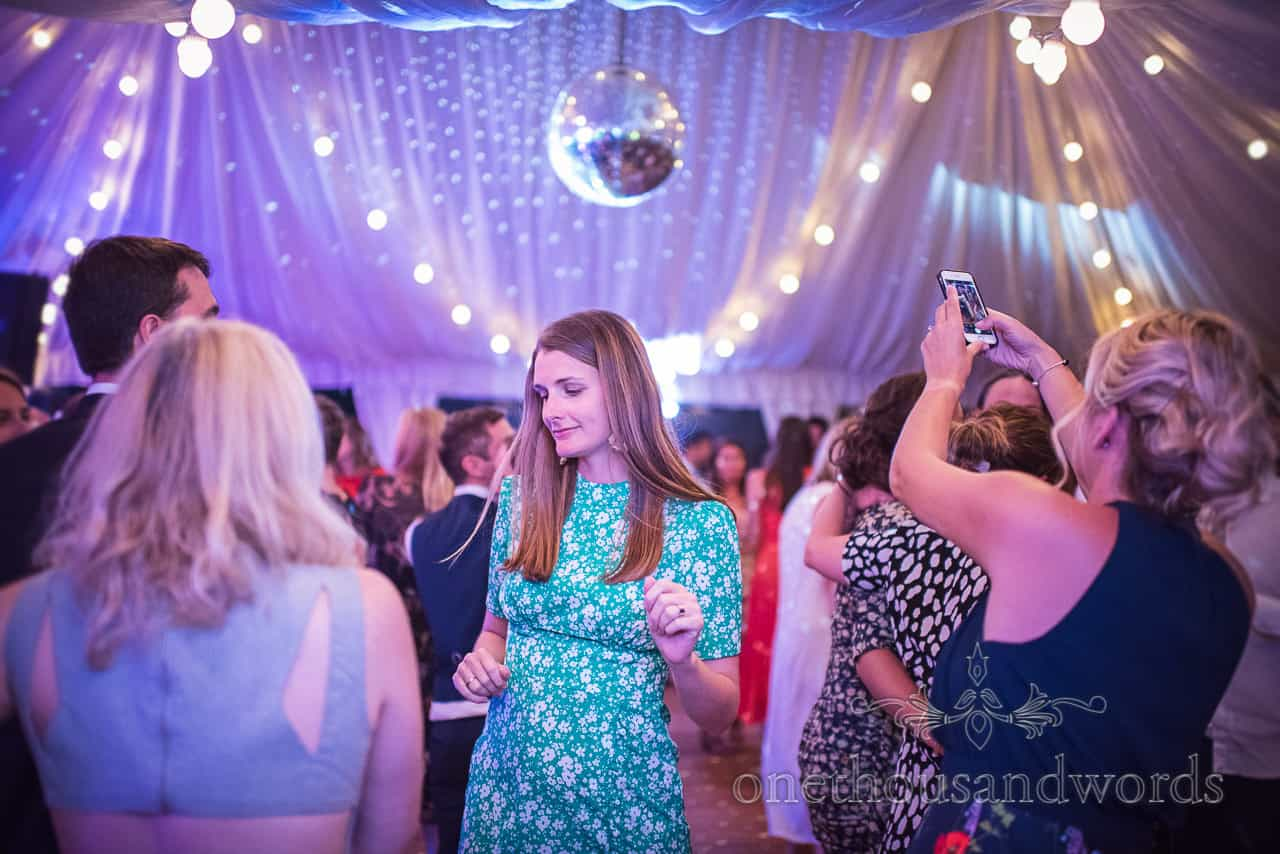 Wedding guests dancing at Sherborne Castle wedding evening in marquee under disco lights and glitter ball