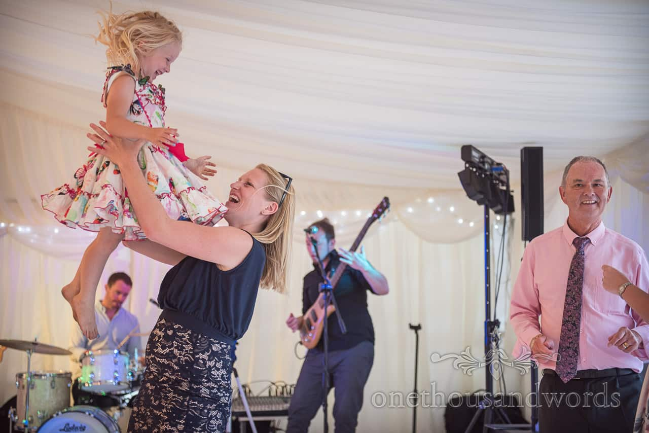 Wedding guest lifts daughter whilst dancing in marquee to Dorset wedding band