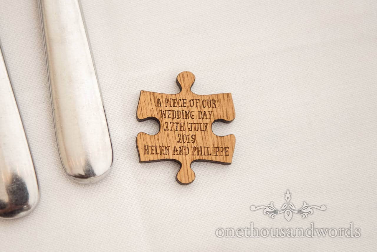 Wedding wooden jig saw piece favours engraved message piece of our wedding day detail photograph