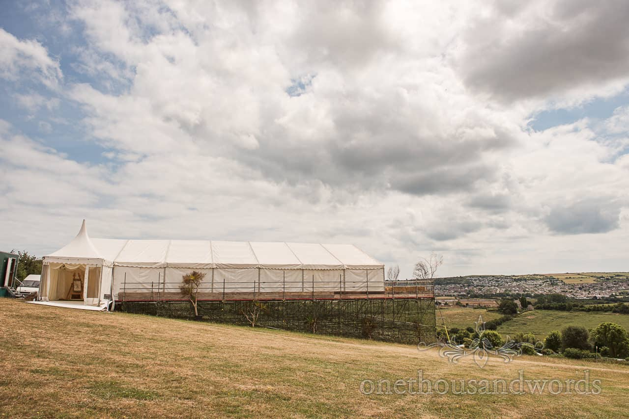 Purbeck marquee wedding photographs of a huge scaffold platform on a countryside hill over looking Swanage in Dorset