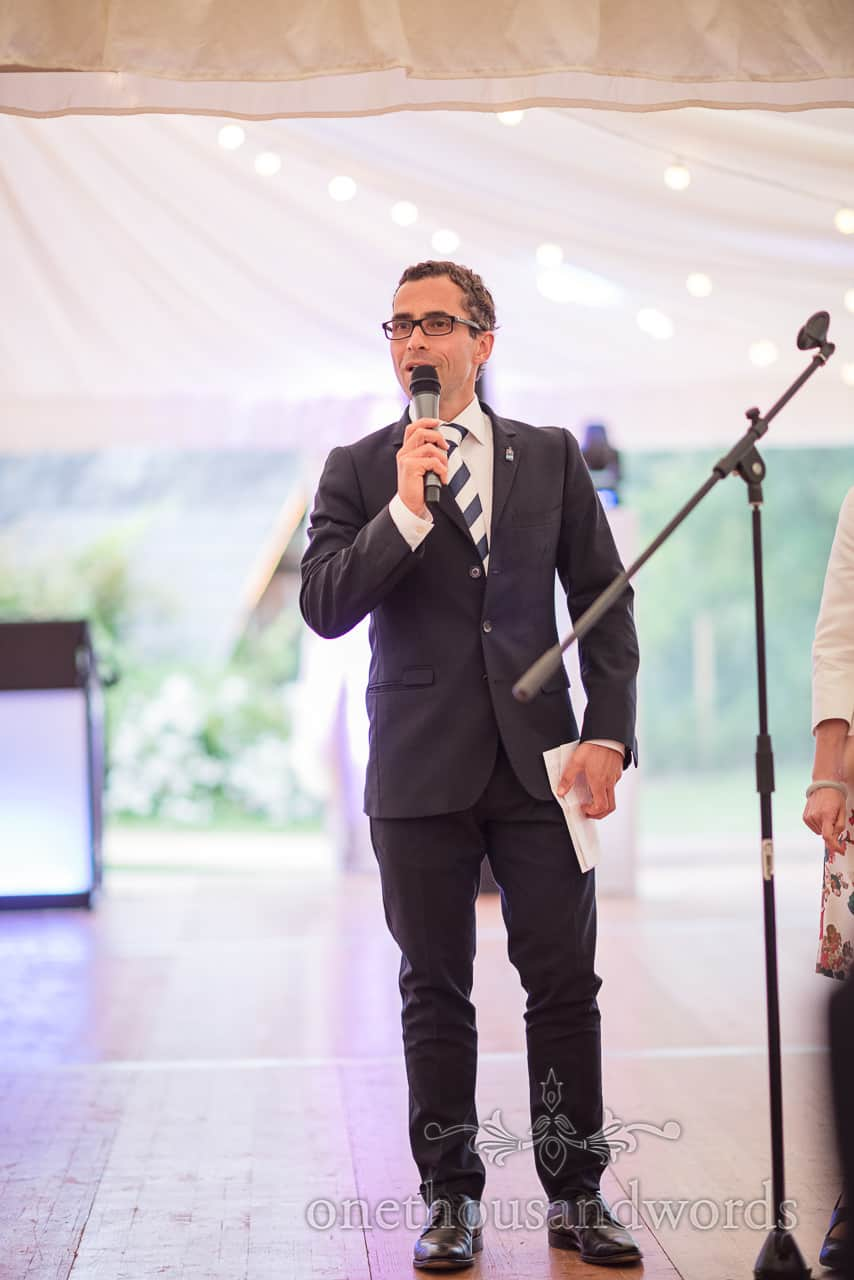 Wedding marquee speeches on wooden dance floor with microphone photograph