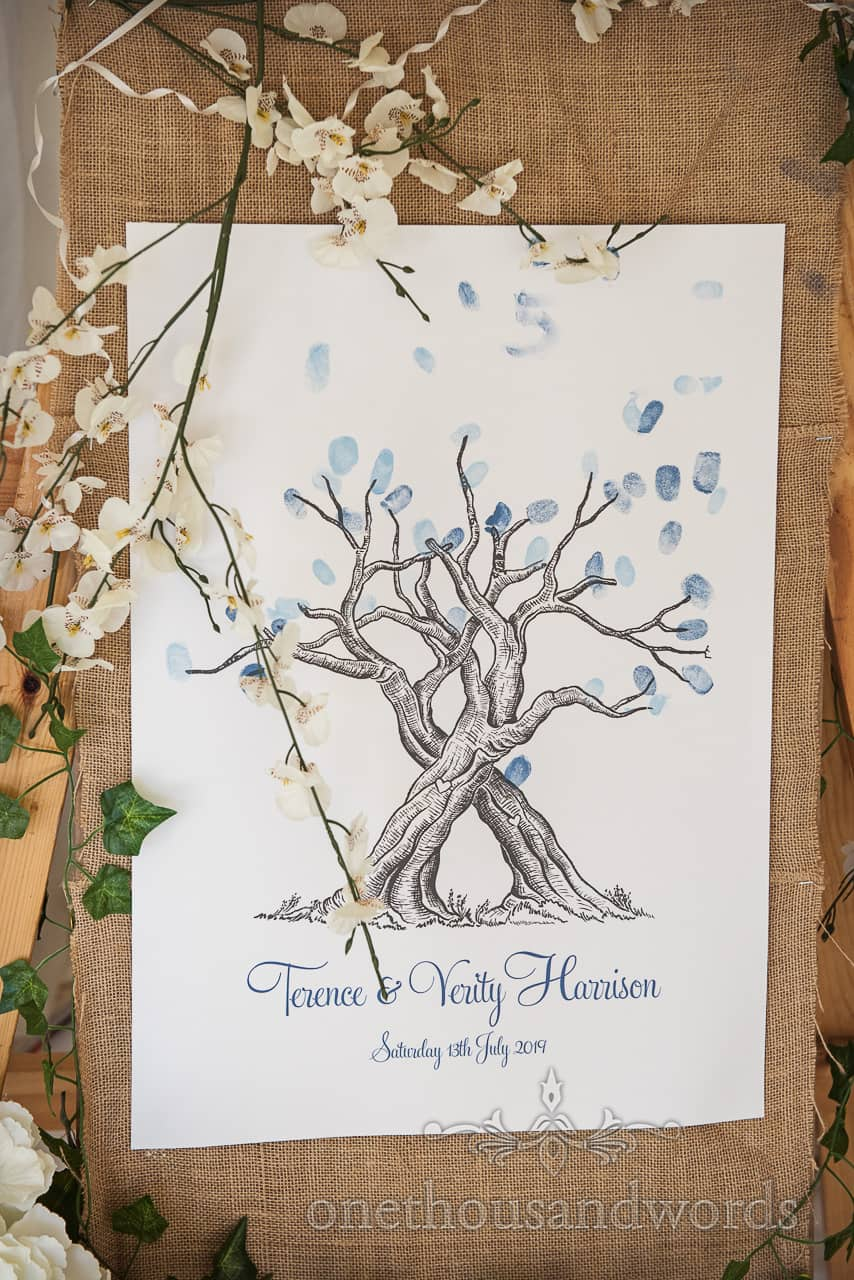 Wedding tree picture with ink finger print leaves picture as wedding guest book idea decorated with ivy and cherry blossom