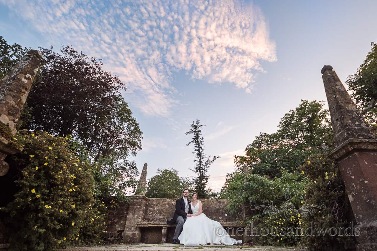 Athelhampton House wedding couple photographs in the garden at sunset by one thousand words
