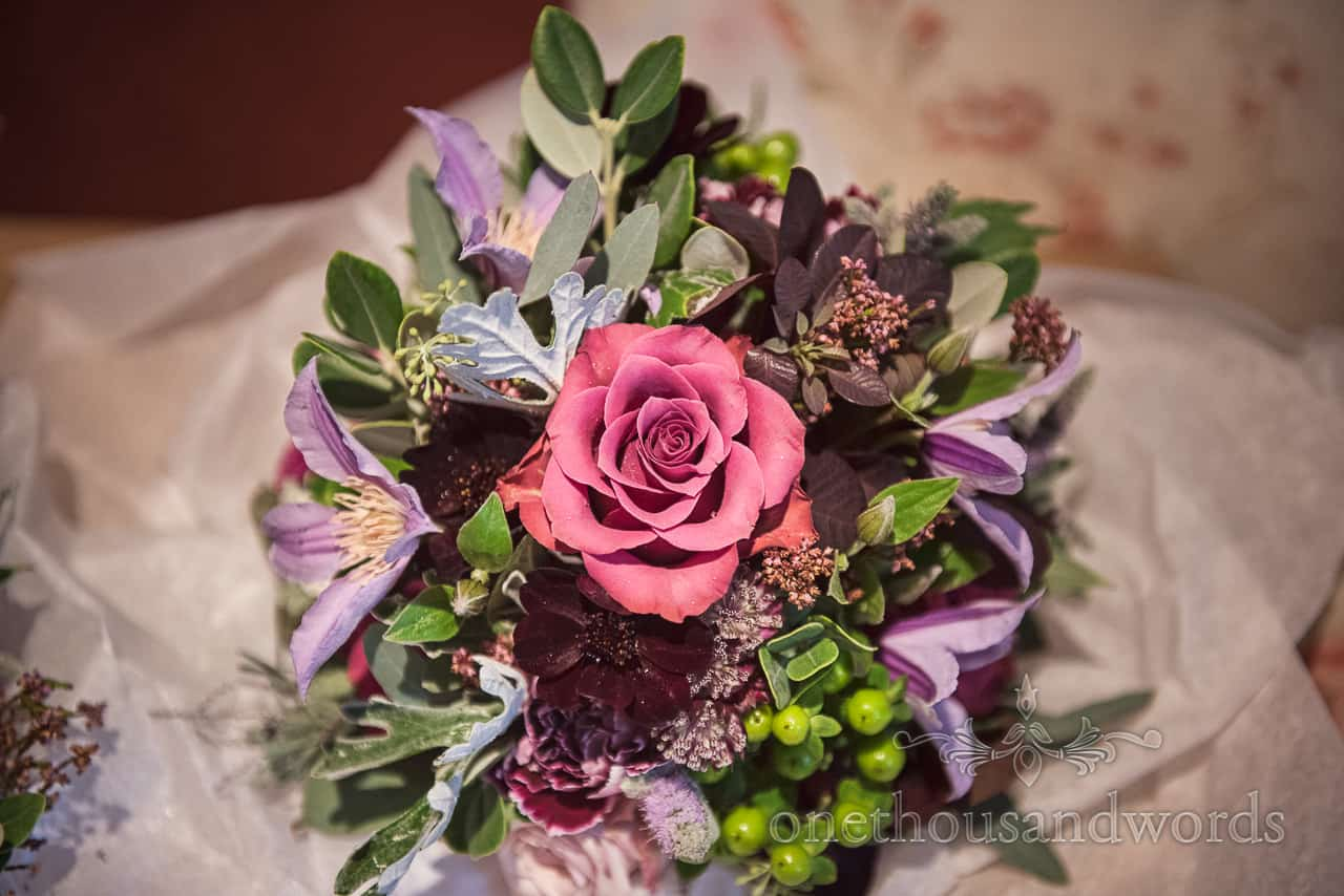 Berry coloured wedding floral bouquet from Athelhampton wedding by one thousand words photography