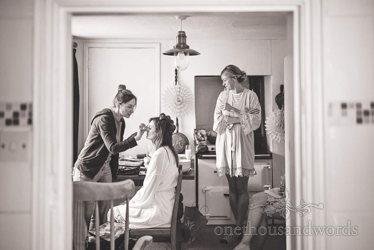 Black and white bridal preparation photograph of wedding make up being applied by one thousand words documentary wedding photography