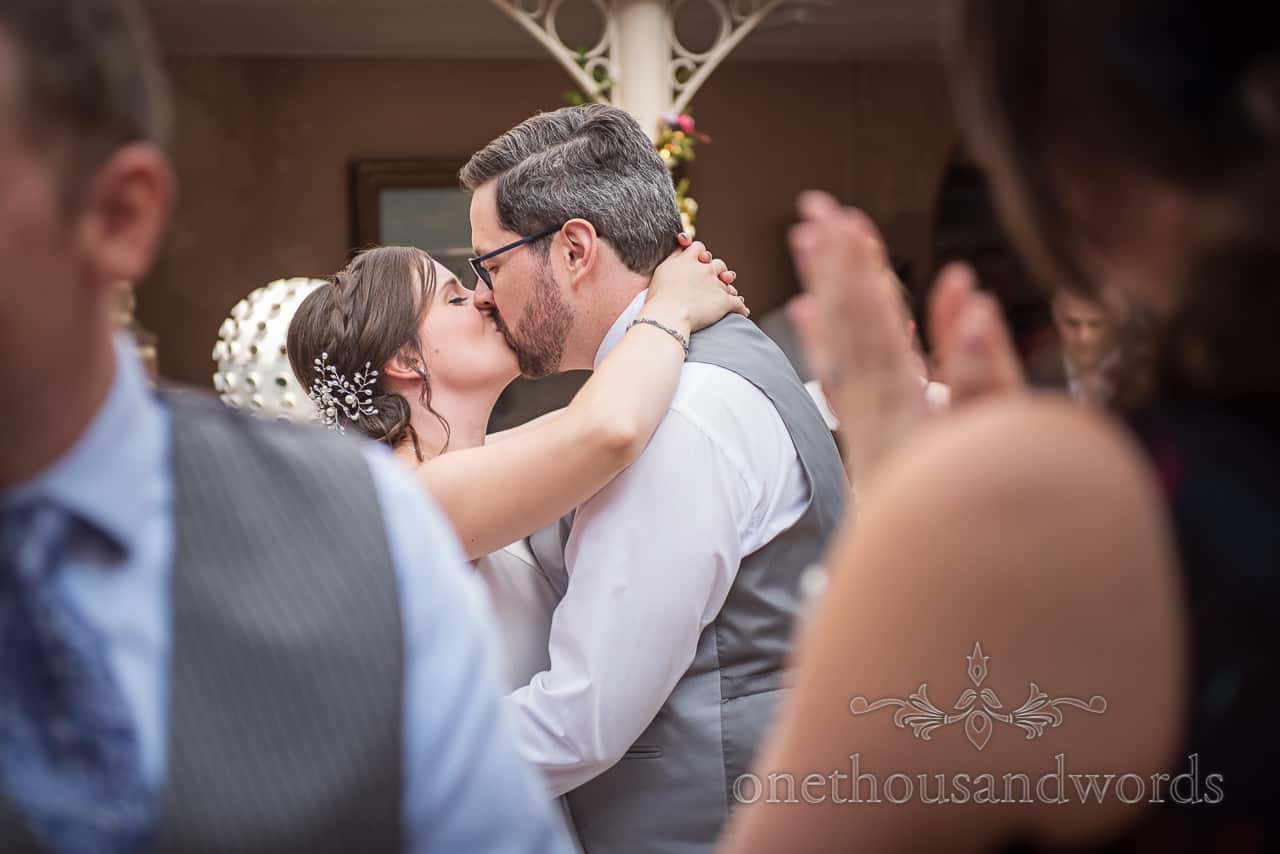 Bride and groom kiss on dance floor at Athelhampton House wedding by one thousand words