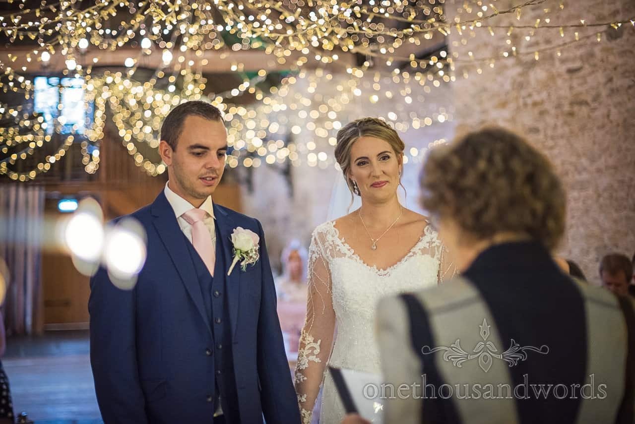 Kingston Country Courtyard wedding ceremony bride and groom under fairy lights from Kingston barn wedding photographs