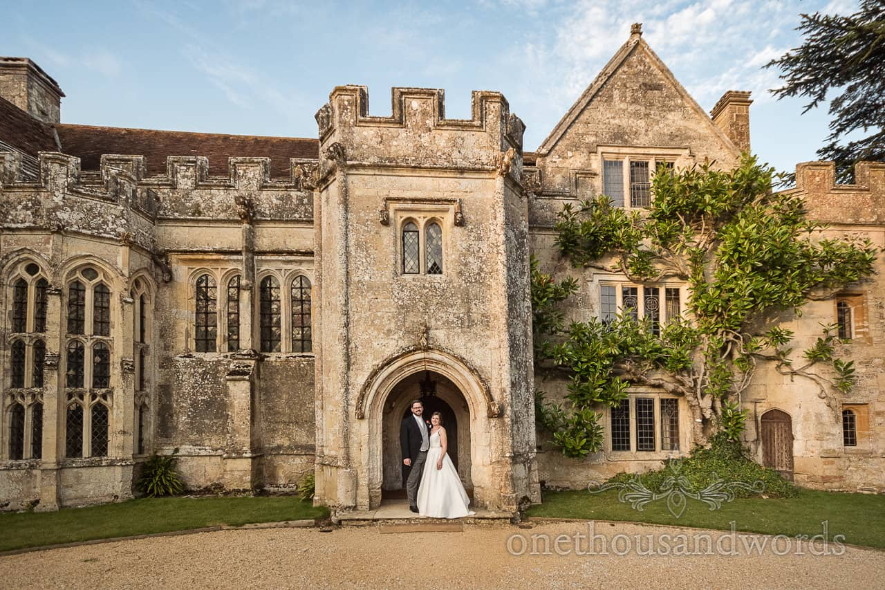 Bride and groom In doorway at Athelhampton wedding photography by one thousand words