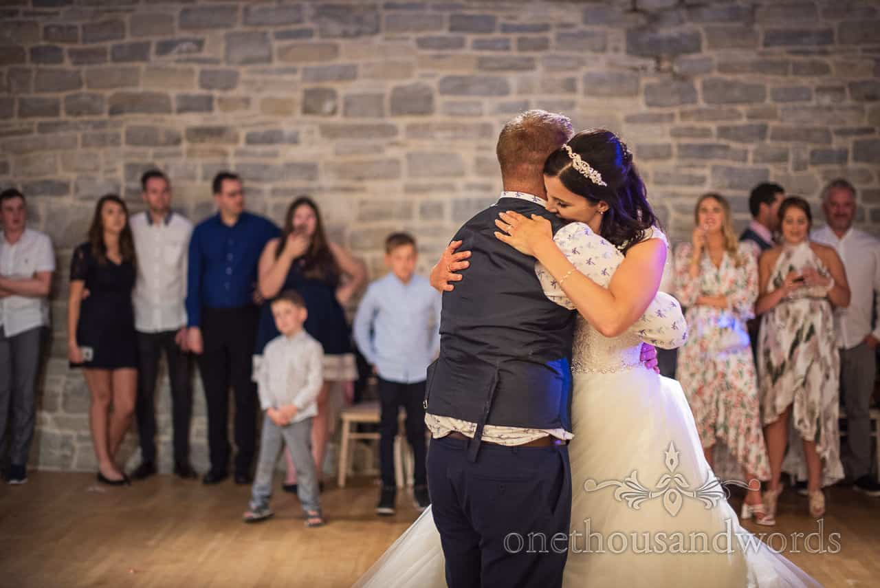 Bride and groom embrace at end of first dance from Purbeck castle wedding