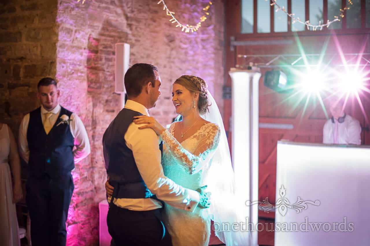 Bride and groom first dance photograph from Kingston Country Courtyard Wedding with DJ lighting and fairy lights