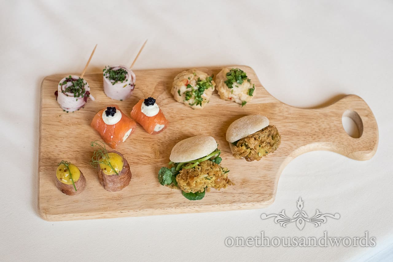 Variety of wedding drinks reception canapés served on a wooded board at Kingston Country Courtyard wedding venue in Dorset