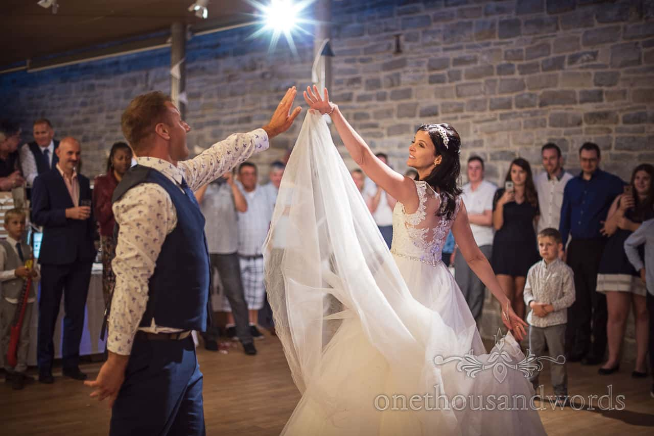Choreographed bride and groom first dance routine on dance floor at Purbeck castle wedding photographs by one thousand words