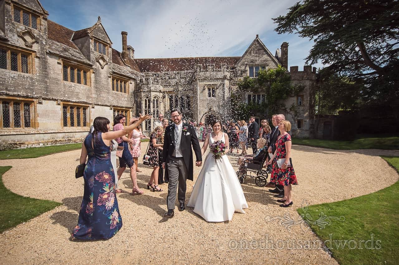 Wedding confetti photograph from Athelhampton wedding photographs by one thousand words wedding photography in Dorset