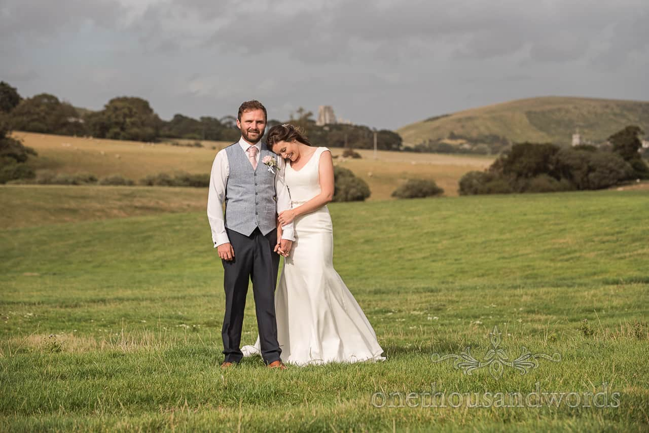 Bride and groom cute couple photograph in Dorset countryside at Purbeck farm marquee wedding photographs