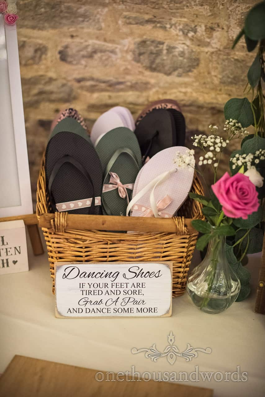 Dancing shoes in wicker basket with if your feet are tired and sore grab a pair and dance some more script sign