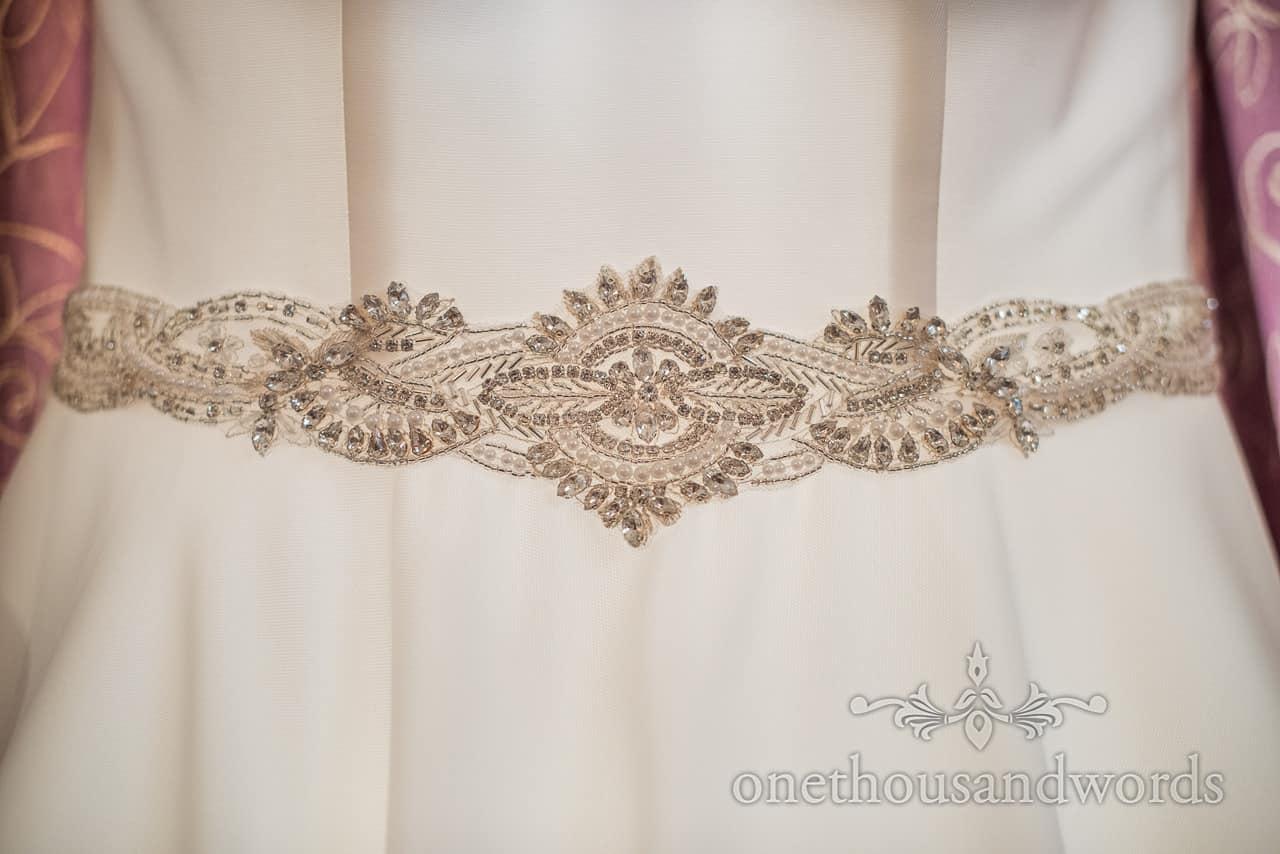 Diamanté beaded white illuminated wedding dress belt detail photograph by one thousand words wedding photography in Dorset