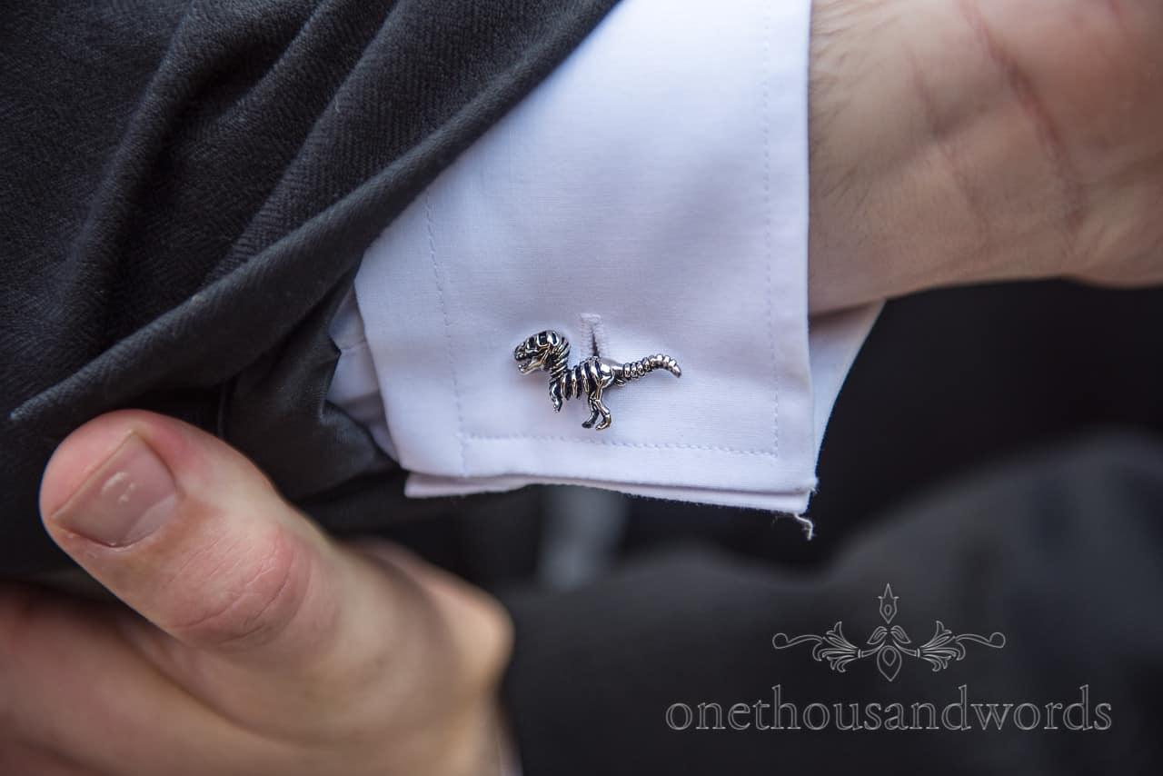 Dinosaur skeleton silver cufflinks wedding detail photograph by one thousand words documentary wedding photography in Dorset