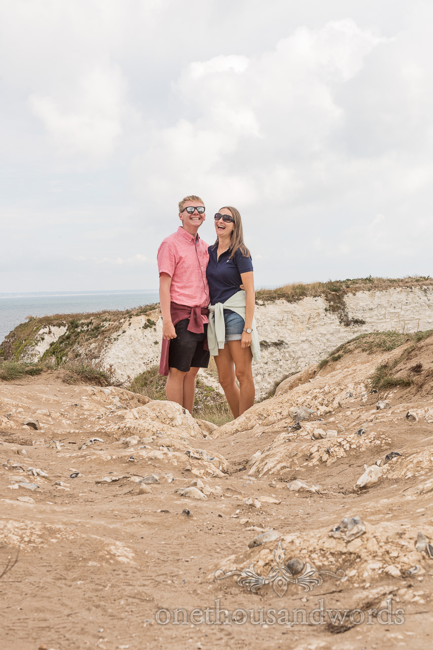 Dorset sea side white cliffs engagement photograph of laughing couple by one thousand words wedding photographers in Dorset