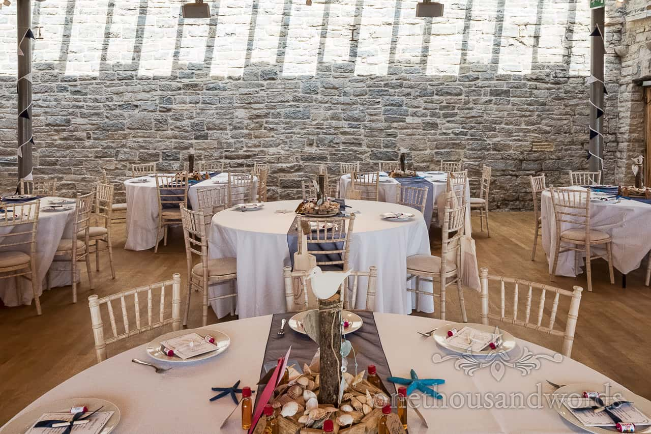 Durlston Castle wedding venue gallery space decorated tables for wedding breakfast by one thousand words photography