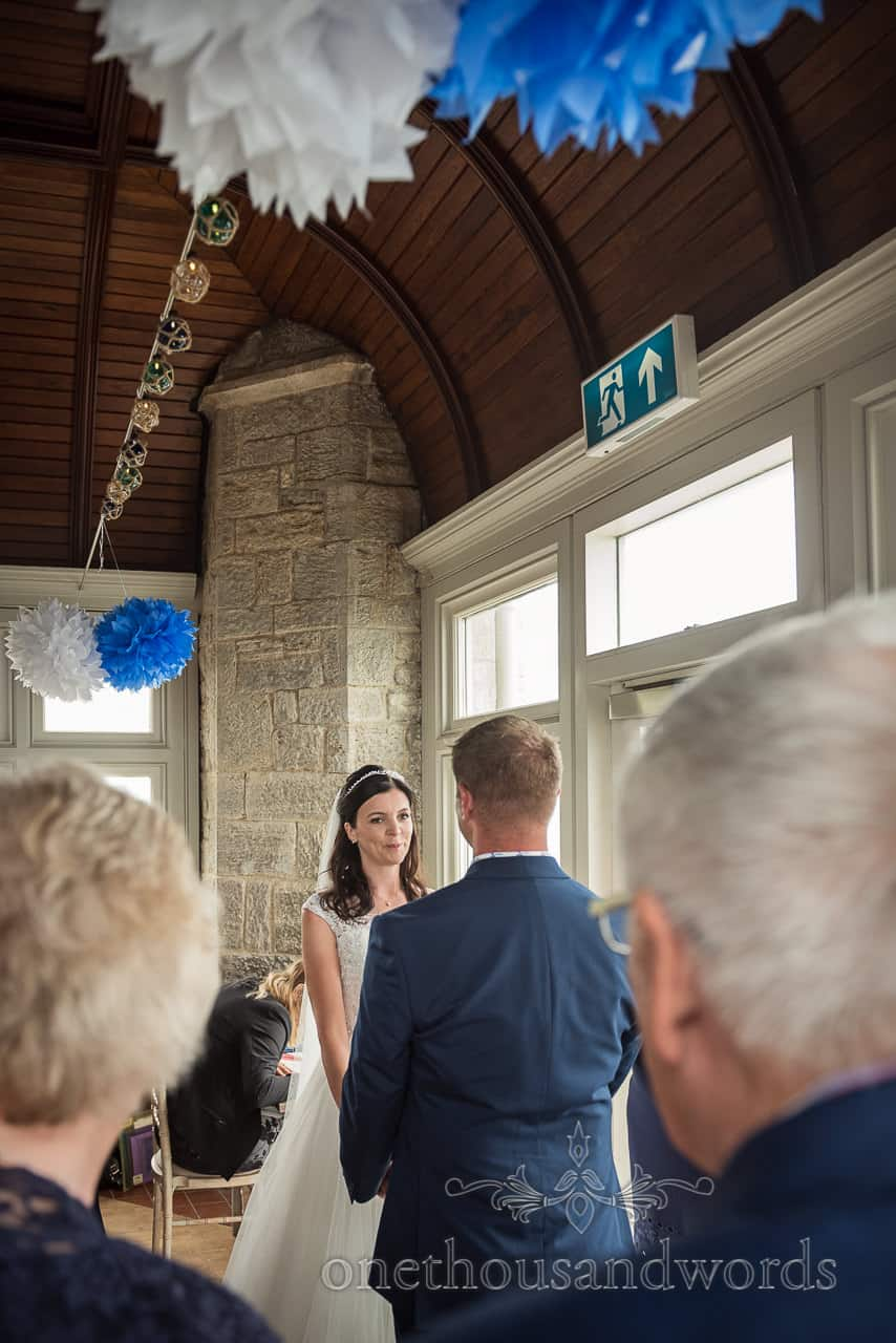 Emotional bride during exchange of vows at civil wedding ceremony in Purbeck Castle by one thousand words wedding photographers