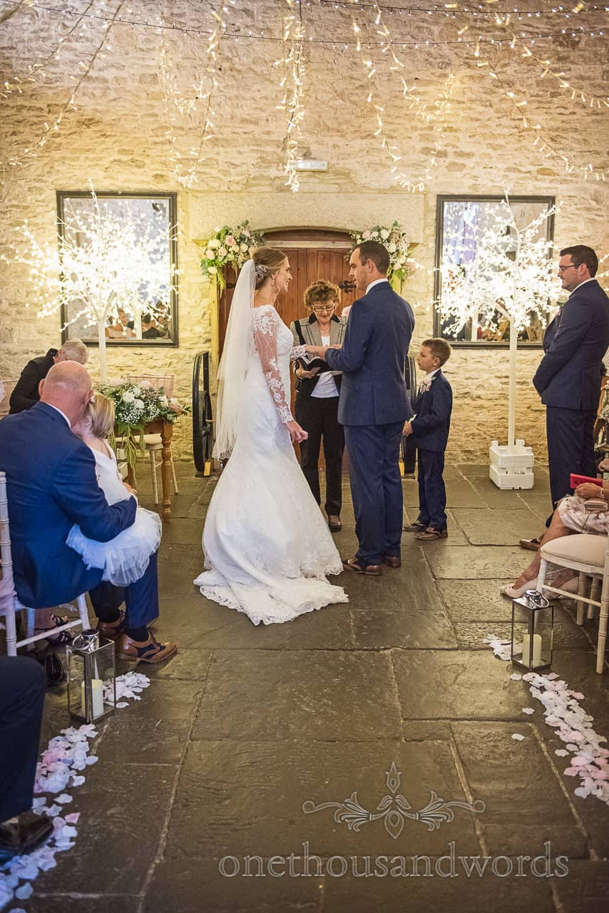 Bride and groom exchange wedding vows in civil ceremony at Kingston Country Courtyard wedding venue in Dorset