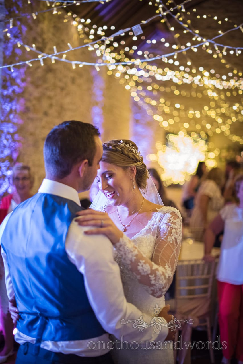 Bride and groom's intimate first dance under fairy lights at Kingston barn wedding venue