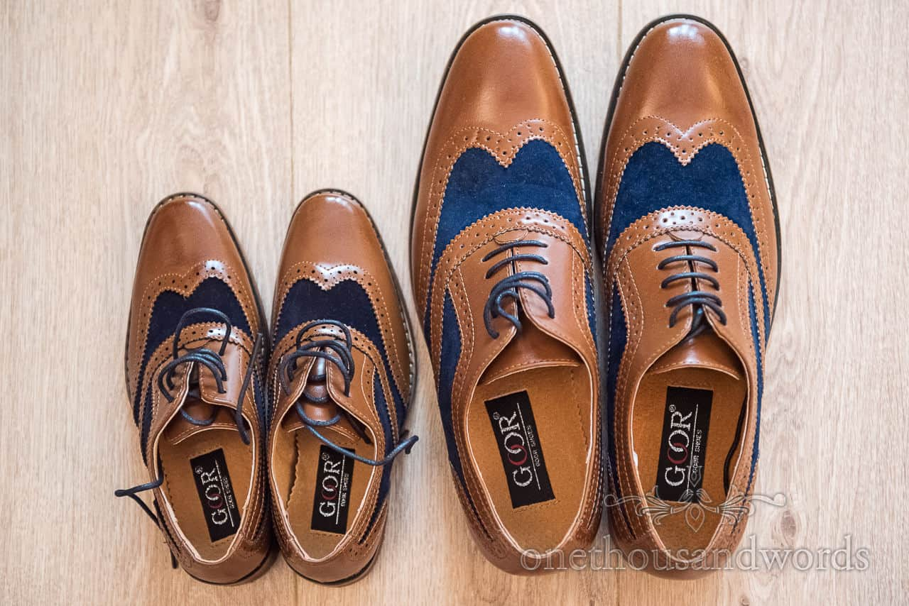 Groom and son's matching tan and blue two tone brogue wedding shoes photographed during wedding morning preparations