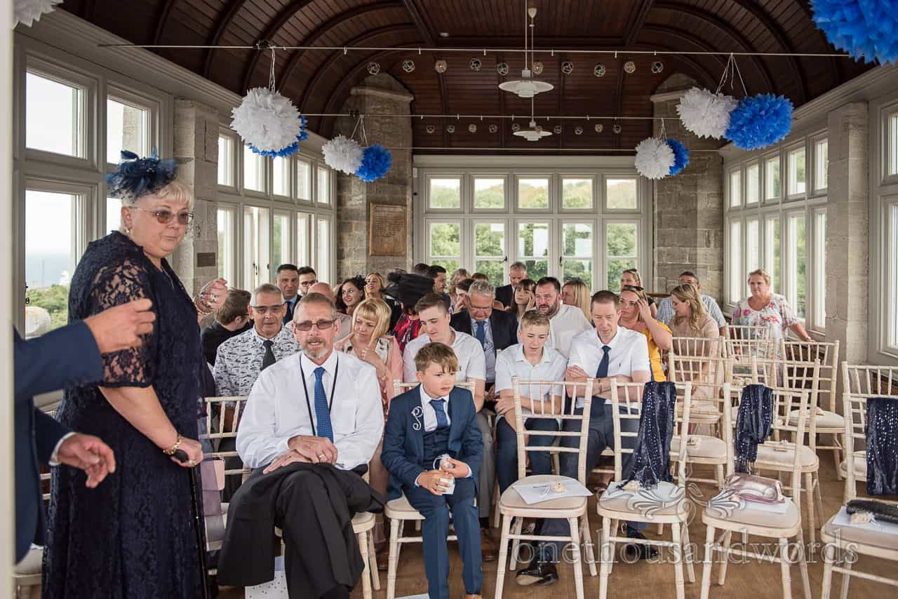 Wedding guests await arrival of the bride in the Belvedere Suite at Purbeck castle wedding venue in Dorset