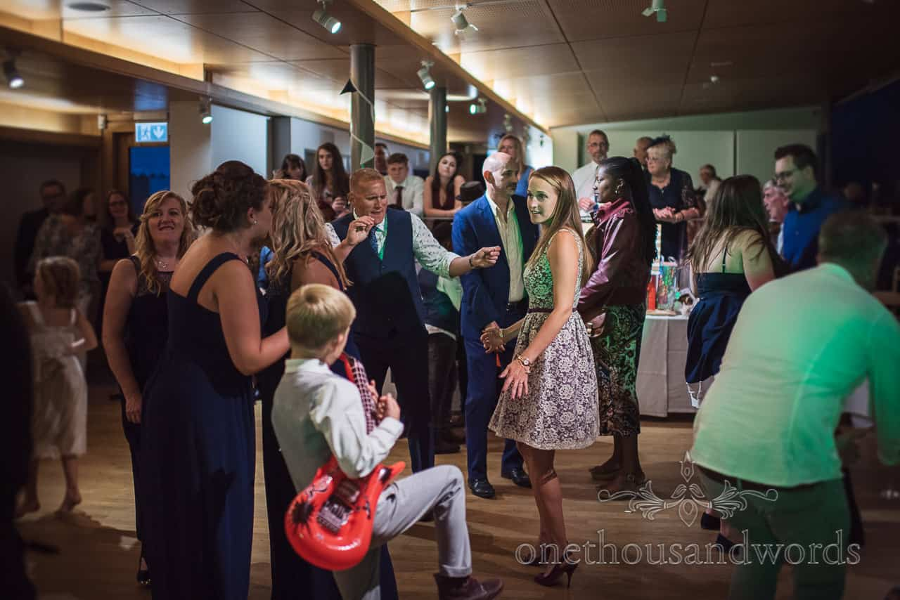 Wedding guests dance in The Gallery at Durlston Castle wedding venue in Dorset