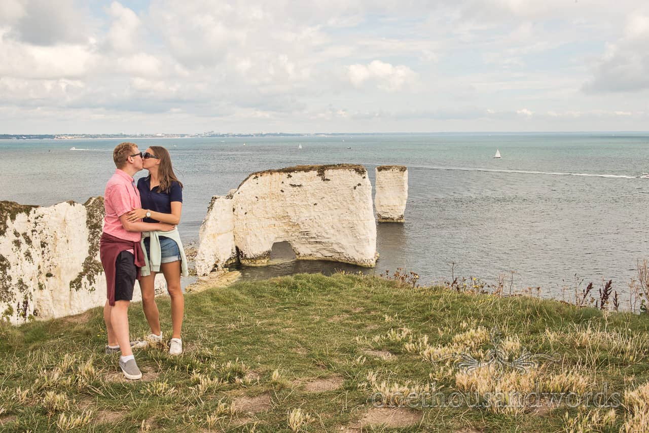 Old Harry Rocks engagement photographs of couple kissing with Dorset sea side by one thousand words wedding photography