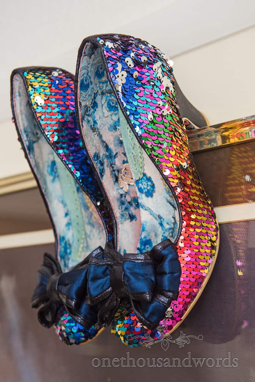 Irregular Choice rainbow sequin bridesmaid shoes with bows on the toes detail wedding photograph by one thousand words