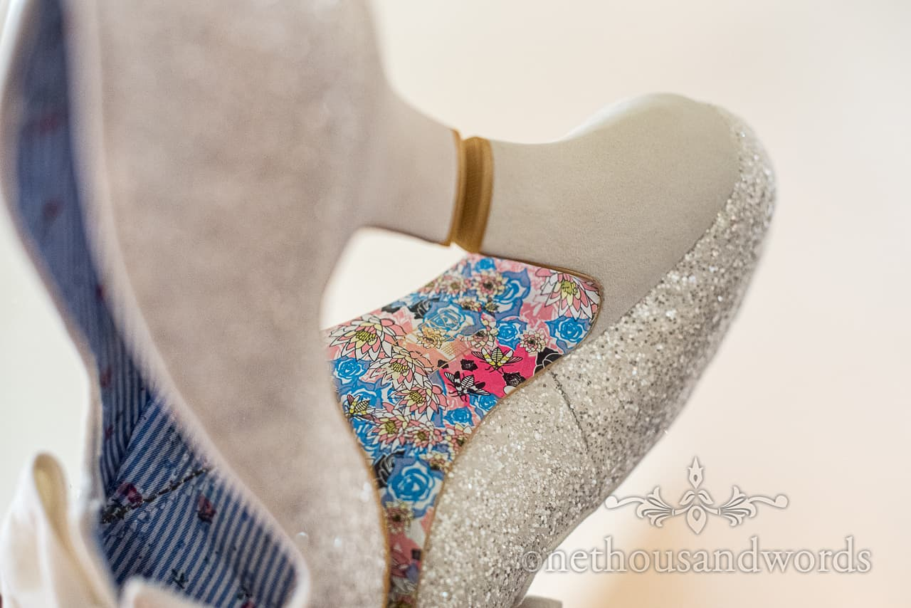 Irregular Choice sparkly silver wedding shoe with heels and detailed multi colour sole reflection detail wedding photo by one thousand words