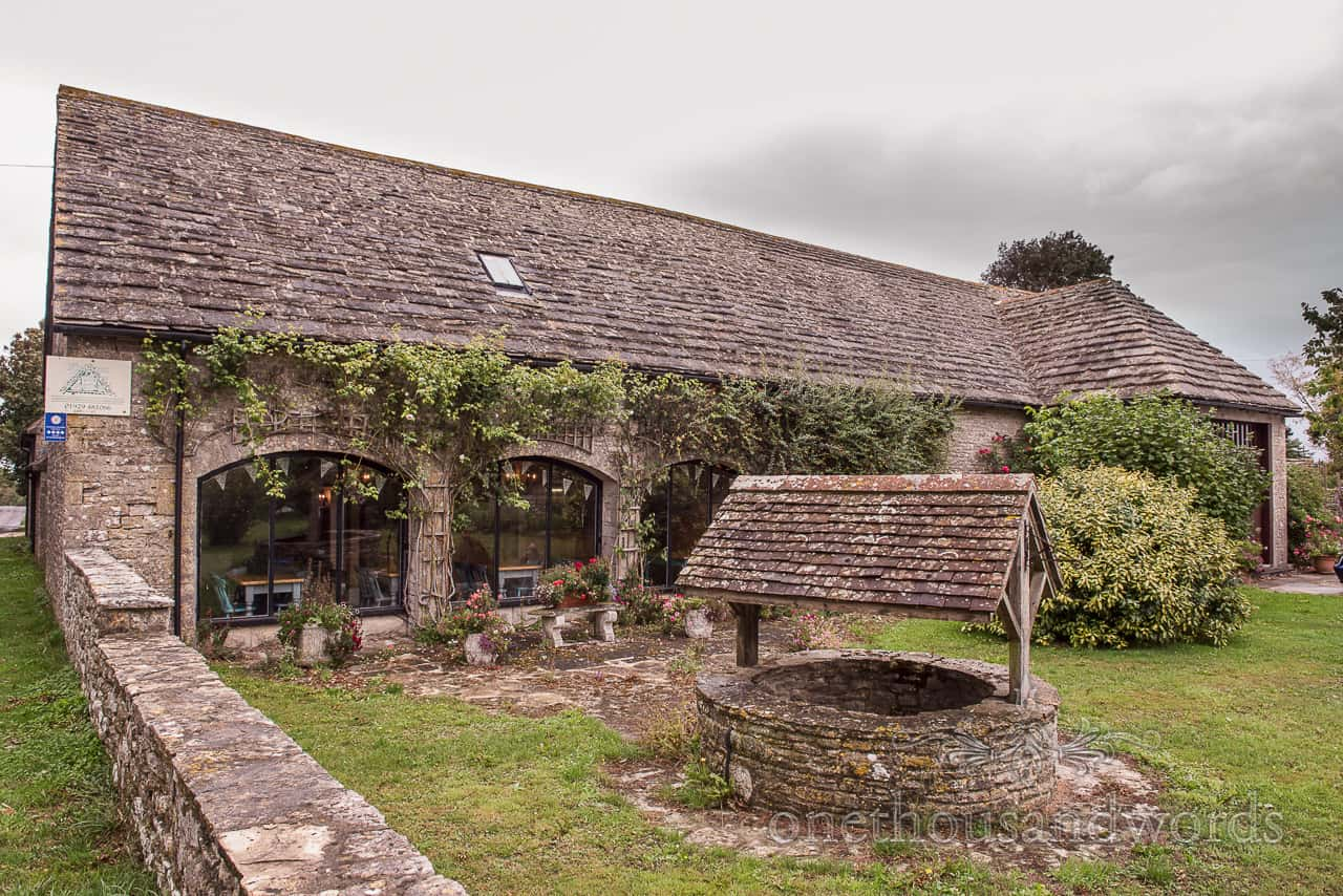 Kingston Country Courtyard barn wedding venue in Dorset on rainy day by one thousand words documentary wedding photography