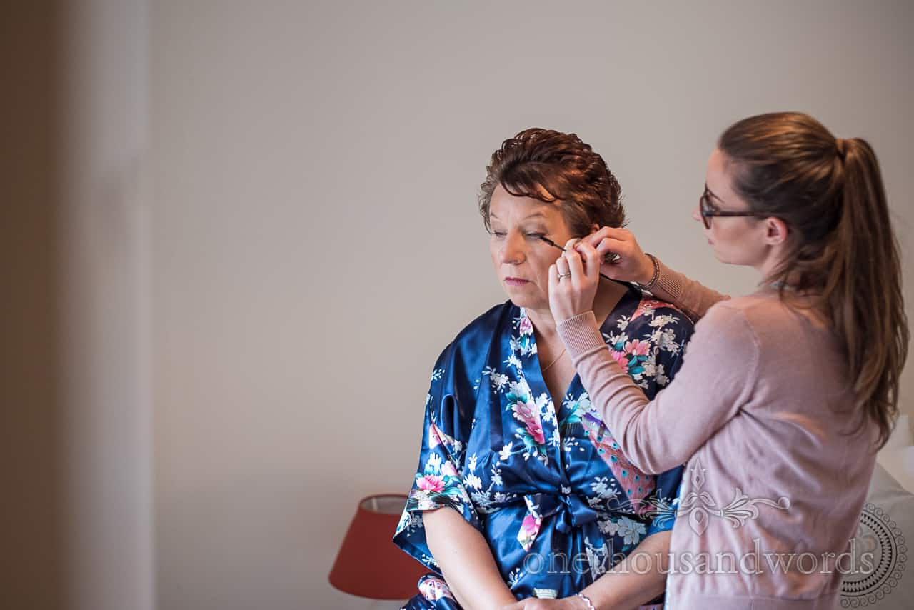 Mother of the groom has wedding make up styled by make up artist on wedding morning in Dorset by one thousand words