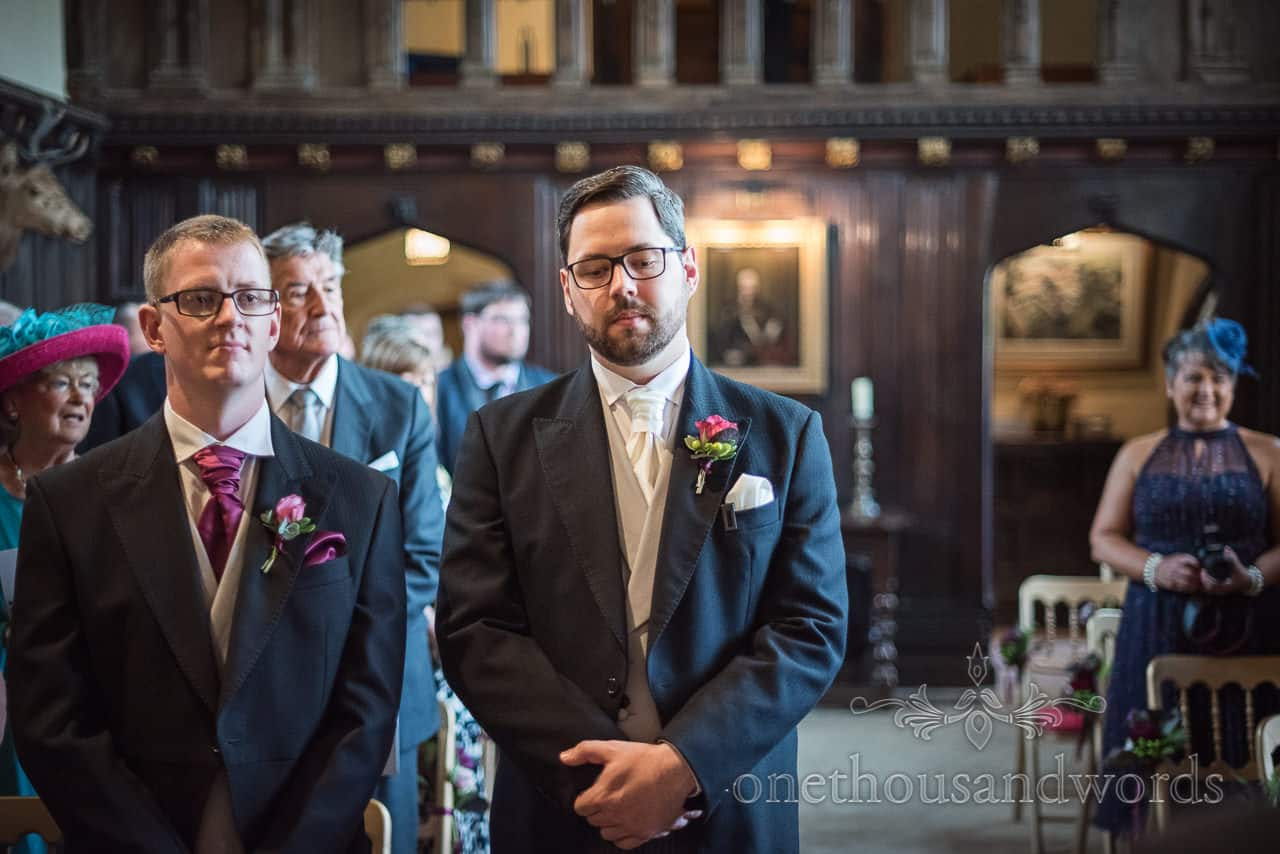 Nervous looking groom waiting for bride at Athelhampton wedding ceremony photographs by one thousand words photography