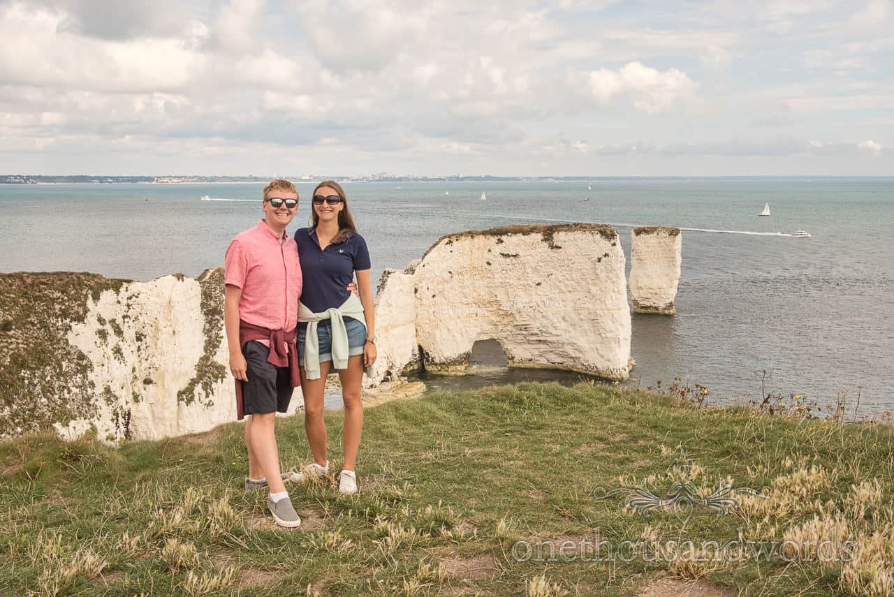Old Harry Rocks engagement photographs with white cliff outcrop and sea views by one thousand words wedding photographers