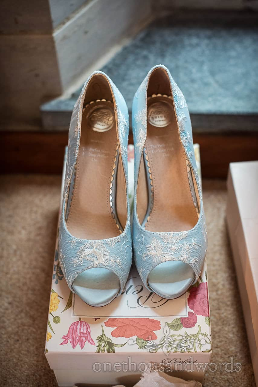 The Perfect Bridal Shoe peeptoe Celia pale blue wedding shoes with lace detail photographed on shoe box on wedding morning