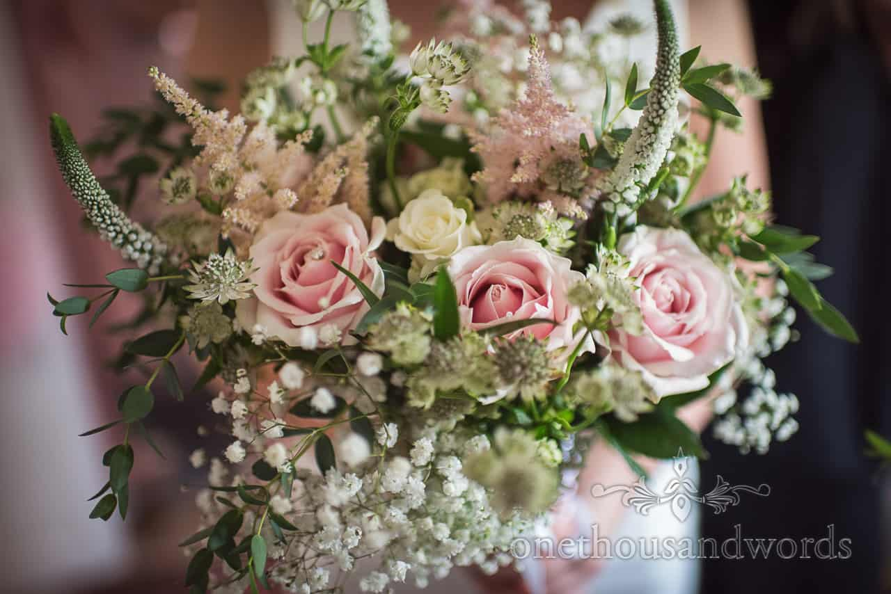 Pink and white wedding flowers with green foliage in countryside bridal bouquet photograph by one thousand words photography