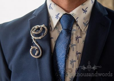 Refinerii Bridal metal buttonhole boutonnière with blue suit, blue sparkly wedding tie and palm tree print shirt
