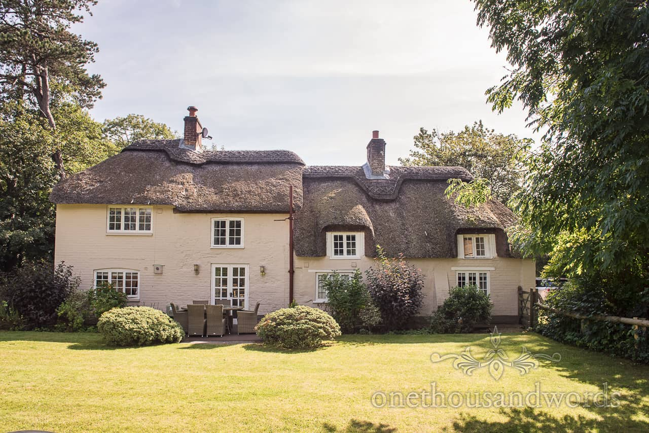 River Cottage at Athelhampton House wedding morning preparation venue thatched cottage by one thousand words photography