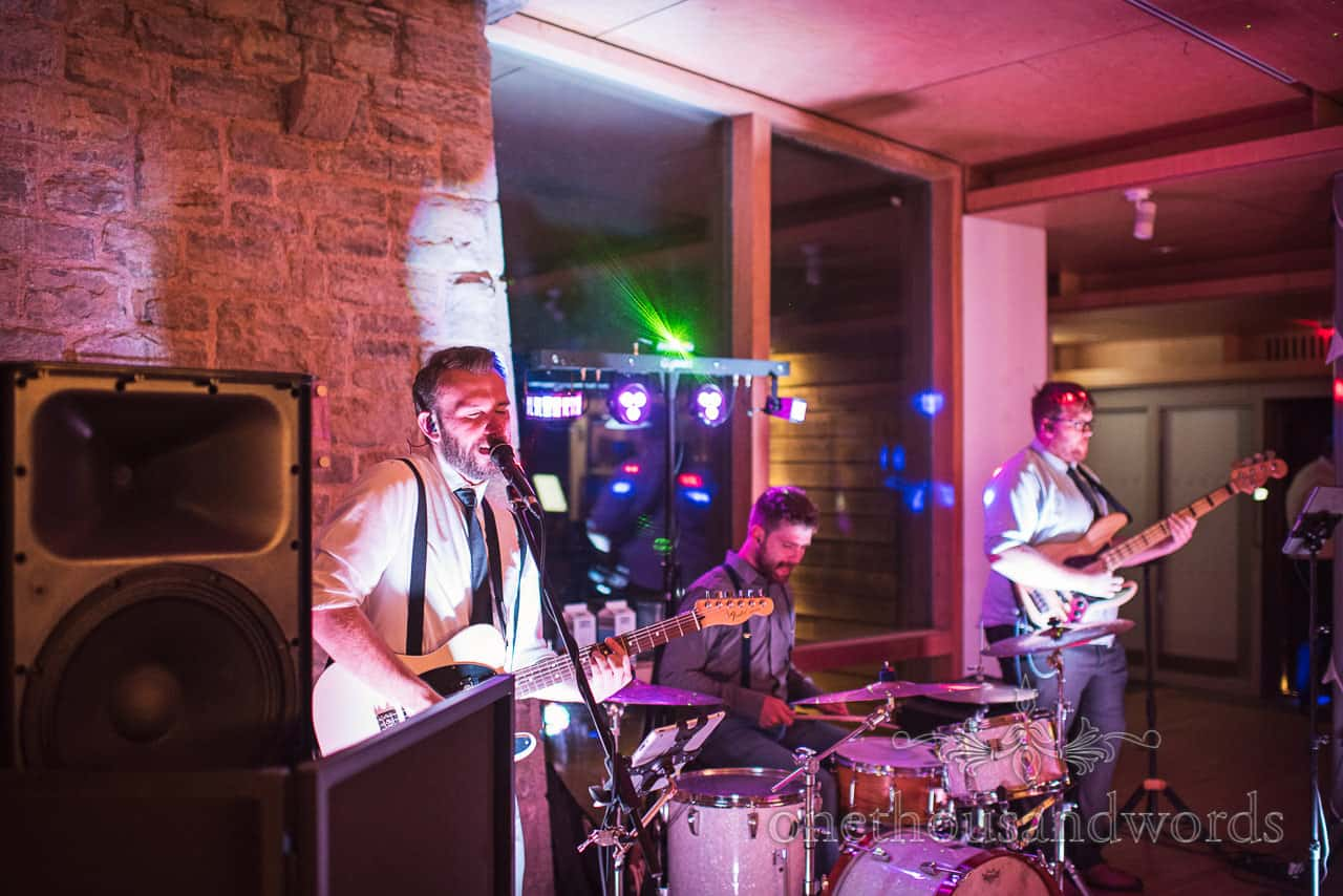Viscounts wedding band play Durston Castle wedding evening reception under multicolour disco lighting photo by one thousand words