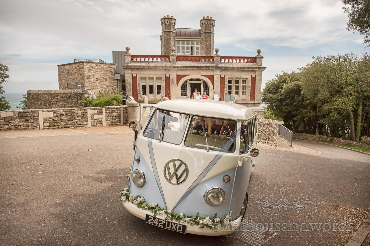 VW camper van split screen wedding transport at Purbeck castle wedding photographs by one thousand words photography in Dorset