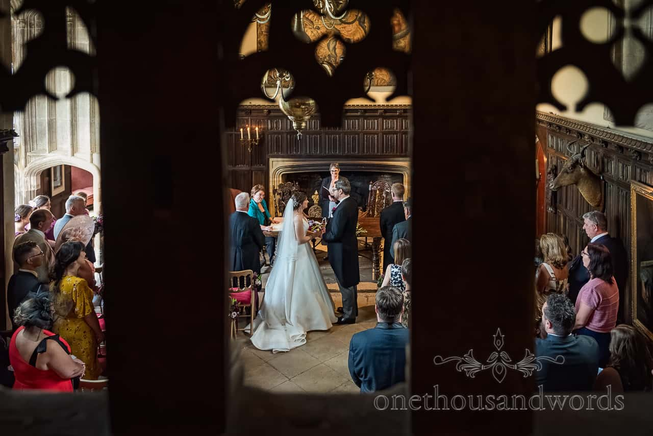 Wedding ceremony at Athelhampton House exchange of vows balcony photograph by one thousand words wedding photography