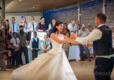 Wedding guests reaction photograph to choreographed first dance at Durlston Castle wedding photograph by one thousand words
