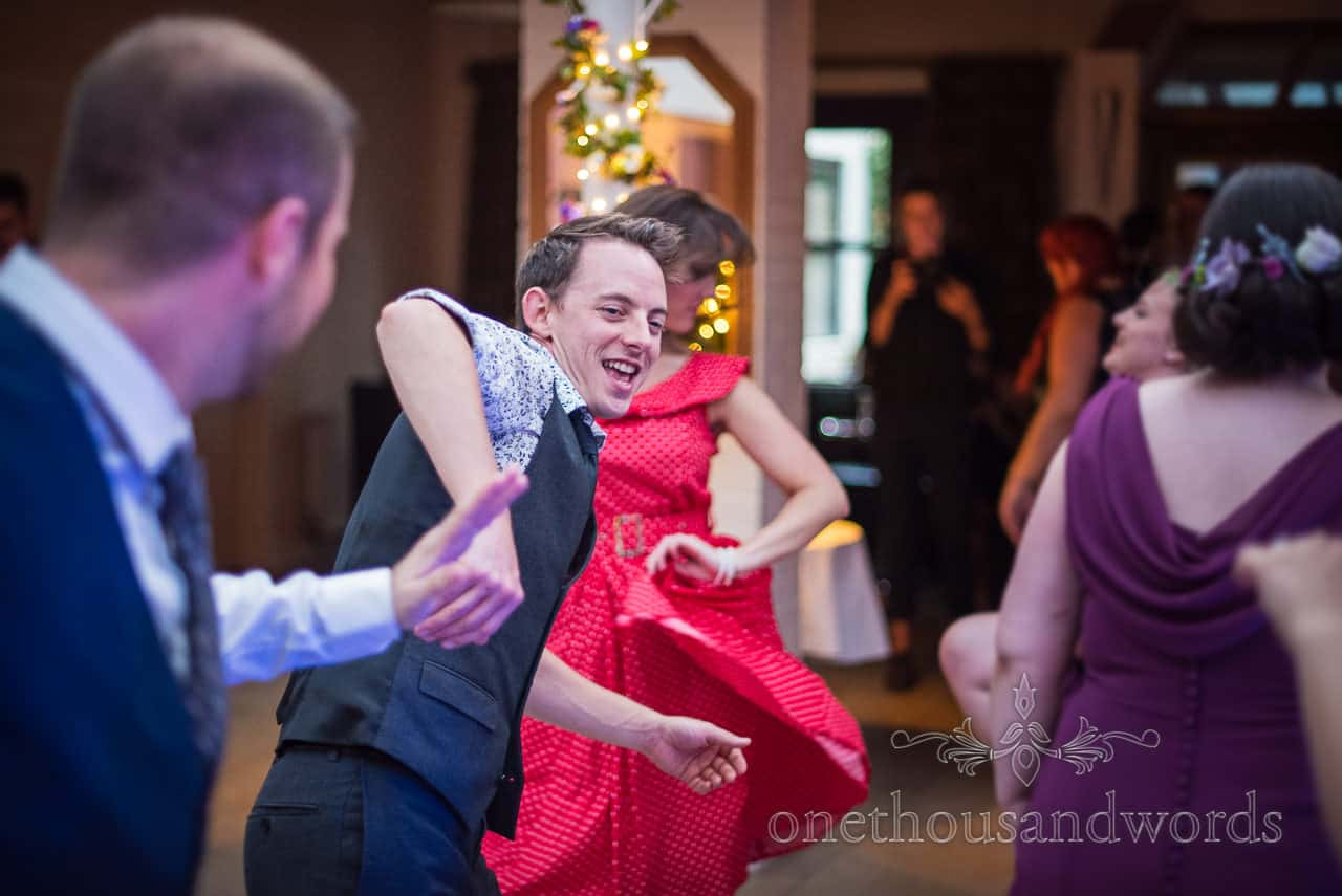 Wedding guests spinning each other on the dance floor wedding dancing photograph by one thousand words wedding photography