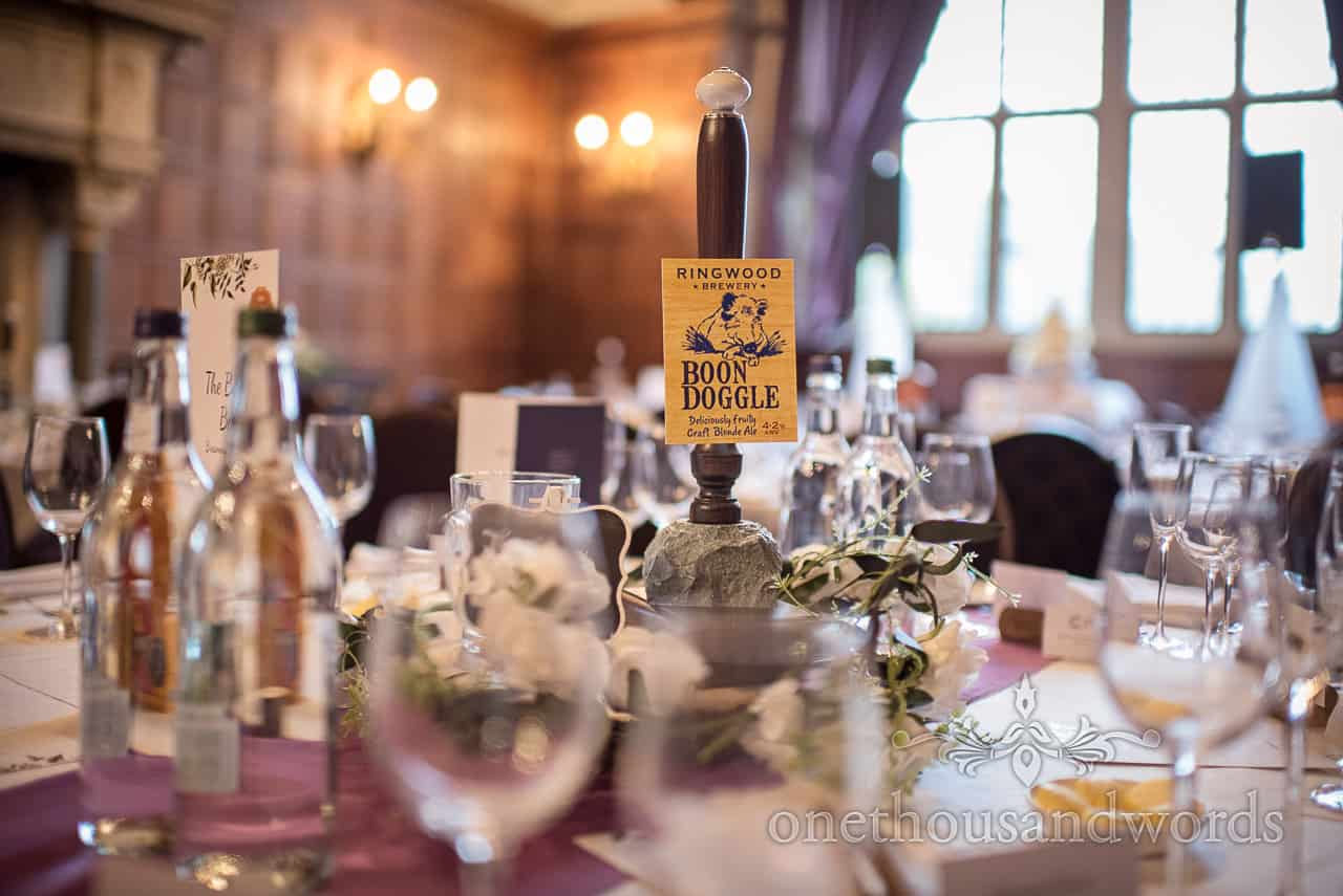 Beer tap wedding table name centerpiece at Rhinefield house wedding venue detail decoration photograph