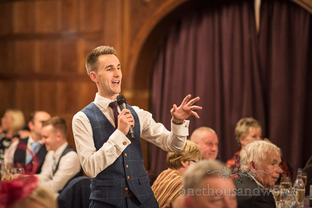 Best man delivers speech at Rhinefield house New Forest hotel wedding venue by one thousand words wedding photography